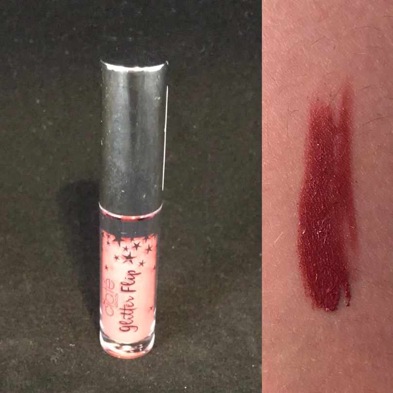 "Photo of sample size Glitter Flip Liquid Lipstick in ""Infamous"" from Ciate London"